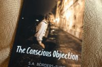book on blanket, book cover, S.A. Borders-Shoemaker, The Conscious Objection, micronovel