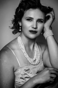 s.a.borders-shoemaker, decade of 30, lessons, love, self-worth, hard work, woman posing with pearls and champagne shirt, black and white